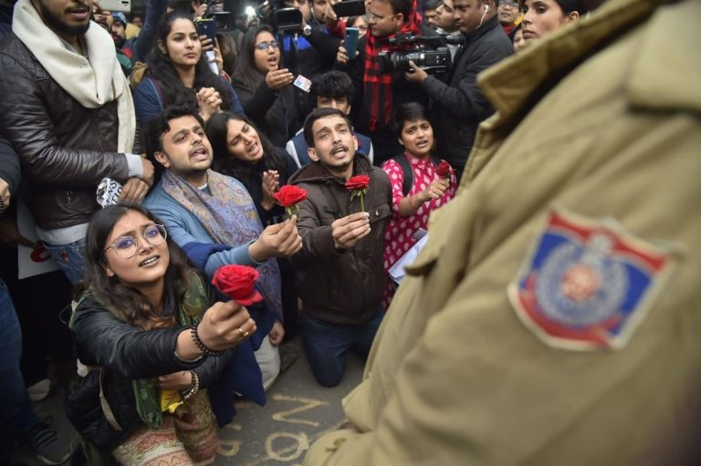 Students Offer Red Roses To Police Amid Unrest And Chaos Over Citizenship Act